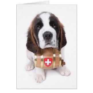 Filhote de cachorro de St Bernard com um cartão de
