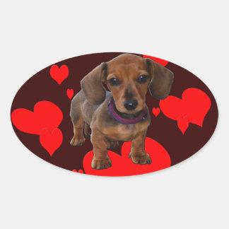 Filhote de cachorro do DACHSHUND com corações Adesivo Oval