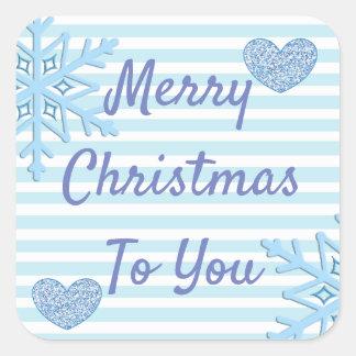 Flocos de neve e coração azuis das etiquetas do