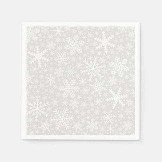 Flocos de neve em guardanapo do feriado da prata |