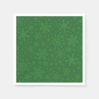 Flocos de neve em guardanapo do feriado do verde |