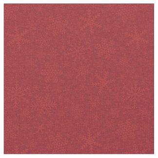 Flocos de neve no tecido do feriado do vermelho |