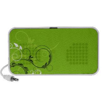 Flora esverdeado e tan escura no backgrou do verde caixinhas de som para notebook