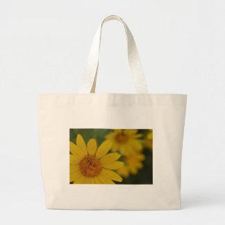 flores amarelas bolsas