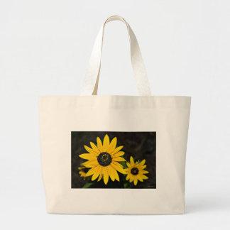Flores amarelas do cone bolsa para compras