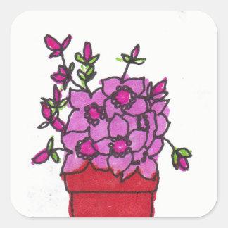 Flores cor-de-rosa na etiqueta de pote vermelha