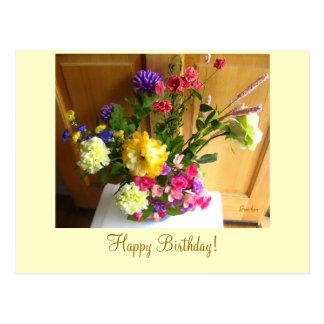 Flores do canto cartão do feliz aniversario