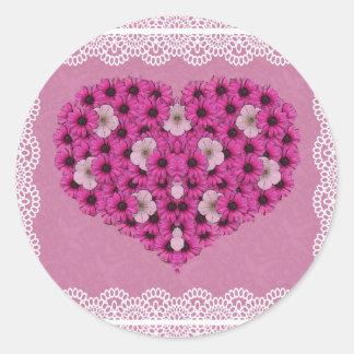 Flores e etiquetas do coração do amor do laço adesivos redondos