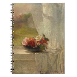 Flores em um caderno da borda da janela