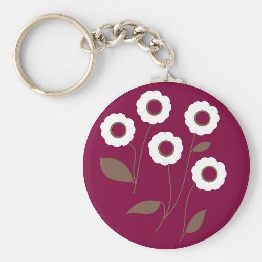 Flores estilizados, em produtos customizáveis chaveiros
