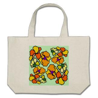 Flores tropicais sobre verde-claro bolsas