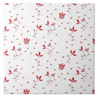 Flores vermelhas em um azulejo branco