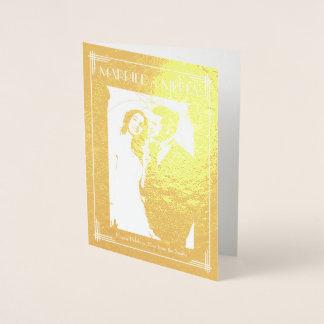 Folha de ouro real casada e cartão do Feliz Natal