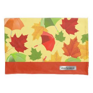 Folhas e guarda-chuvas de outono
