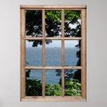 Folhas e opinião do mar de uma janela poster