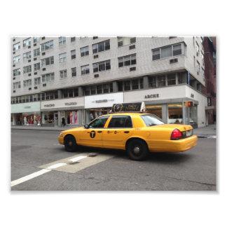 Foto Carro Checkered amarelo do táxi de táxi da Nova