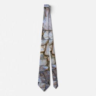 Foto da textura da parede da rocha no laço 2 gravata