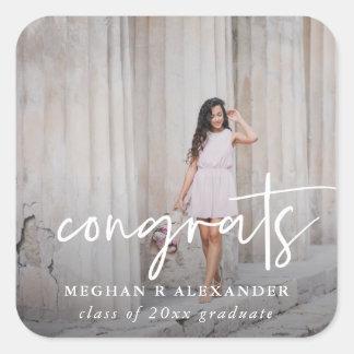 Foto de Congrats e etiqueta graduadas do nome
