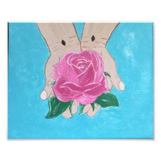 Foto Em suas mãos