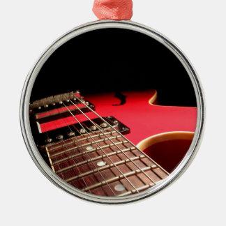 Foto vermelha brilhante da guitarra elétrica enfeites de natal