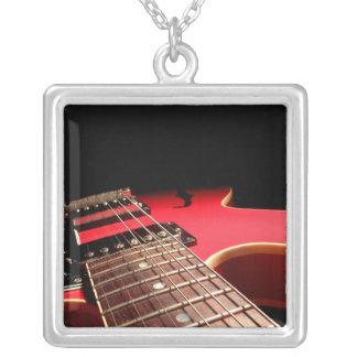 Foto vermelha da guitarra elétrica - PERSONALIZE Bijuterias