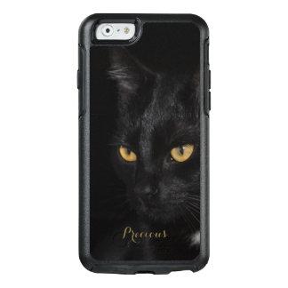 Fotografia bonita da noite dos olhos do gato preto