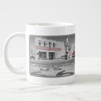 Fotografia vermelha do respingo da arizona de caneca de café gigante