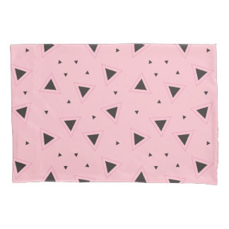 Fronha de almofada cor-de-rosa e geométrica do