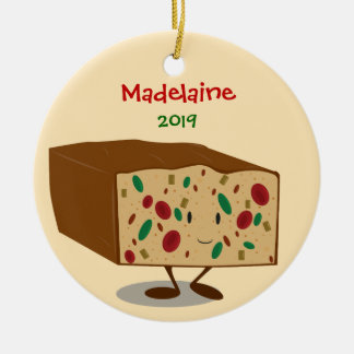 Fruitcake bonito com o ornamento do nome e do ano