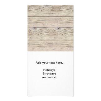 Fundo da madeira lançada costa cartão com foto