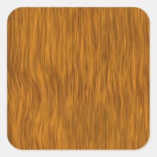 Fundo de madeira áspero dourado da textura adesivo quadrado