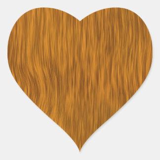 Fundo de madeira áspero dourado da textura adesivo em forma de coração