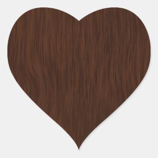 Fundo de madeira áspero escuro da grão adesivo coração