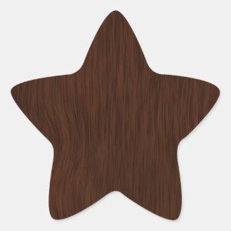 Fundo de madeira áspero escuro da grão adesivo estrela