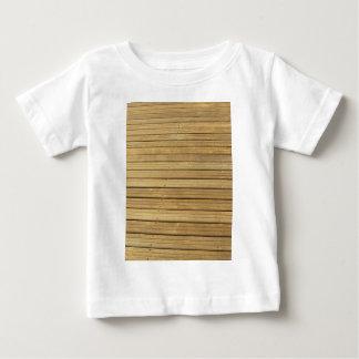 Fundo de madeira da textura do marrom da prancha camiseta para bebê