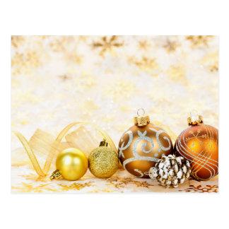 Fundo dourado dos enfeites de natal cartão postal
