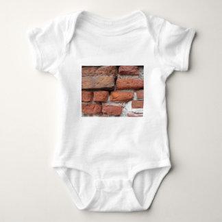 Fundo velho da parede de tijolo body para bebê