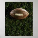 Futebol americano na grama, vista de cima de posteres
