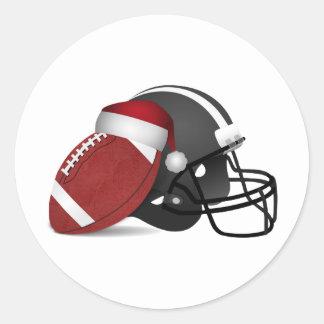 Futebol e capacete do Natal Adesivo Redondo