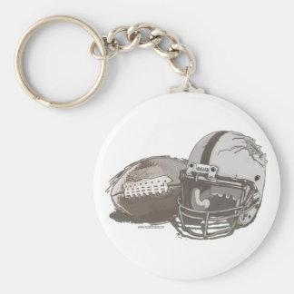Futebol e capacete por estúdios de Mudge Chaveiro