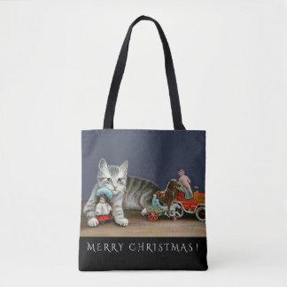 Gato de gato malhado e o bolsa de prata do Natal
