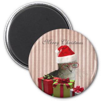 Gato engraçado na moda do papai noel do Natal Imã