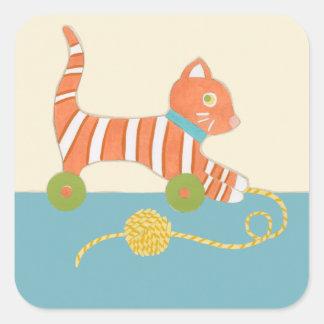Gato listrado do brinquedo com a bola da corda adesivo quadrado
