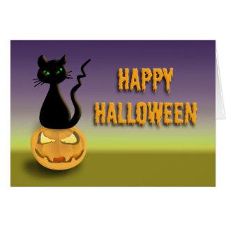 Gato no cartão feliz do Dia das Bruxas da abóbora