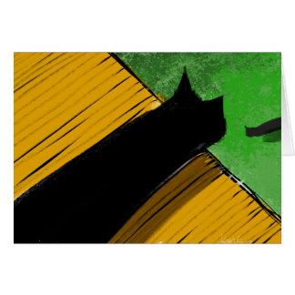 Gato preto em um telhado que olha sobre a borda cartoes
