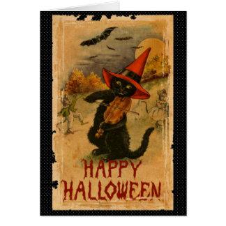 Gato preto feliz do Dia das Bruxas que joga Cartão