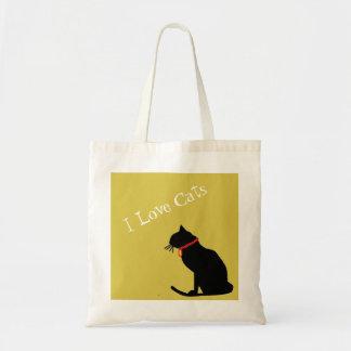 Gatos do amor de BudgetI amarelos e o bolsa