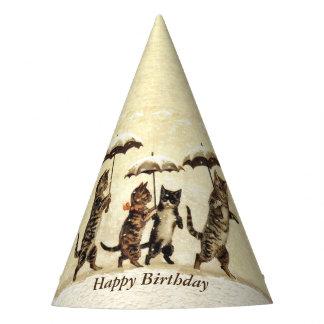 Gatos do aniversário que andam verticalmente em chapéu de festa