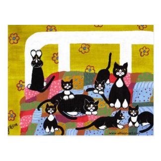 Gatos no cartão da cama