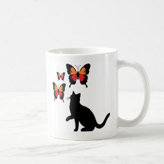 Gatos pretos e caneca das borboletas